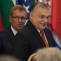 Hungarian Prime Minister Viktor Orban (front) and Gyorgy Matolcsy (back) governor of the Hungarian National Bank arrive to an opening ceremony of the 16+1 China-CEEC Central Bank Governors' Meeting in Budapest, Hungary on Nov. 9, 2018. ATTILA VOLGYI