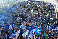 Brighton players celebrate on the stage with confetti during the Brighton & Hove Albion Football Club Promotion Parade at Brighton Seafront, Brighton, United Kingdom on 14 May 2017. Photo by Phil Duncan.