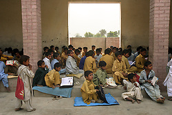 Students are seen at the school that Mukhtar Mai created in Meerwala, Pakistan, April 29, 2005. Mai, 33, went against the Pakistani tradition of committing suicide when she brought charges against the men who gang raped her nearly three years ago. With money from the ruling she opened two schools, one for girls, the other for boys, citing that education is the only thing that will stop such acts from happening.