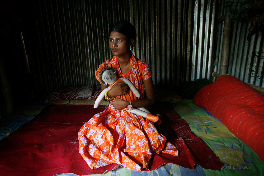 Sex worker Ratna, 13, is seen at brothel in Dorothea, Bangladesh. She has been working as a sex worker for 4 years.