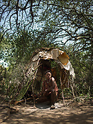 Gnogna in front of his house. Staying in Mandagao camp in Mangola, a touristic destination to see the Hadza community.