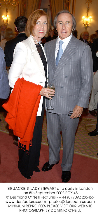 SIR JACKIE & LADY STEWART at a party in London on 5th September 2002.PCX 48