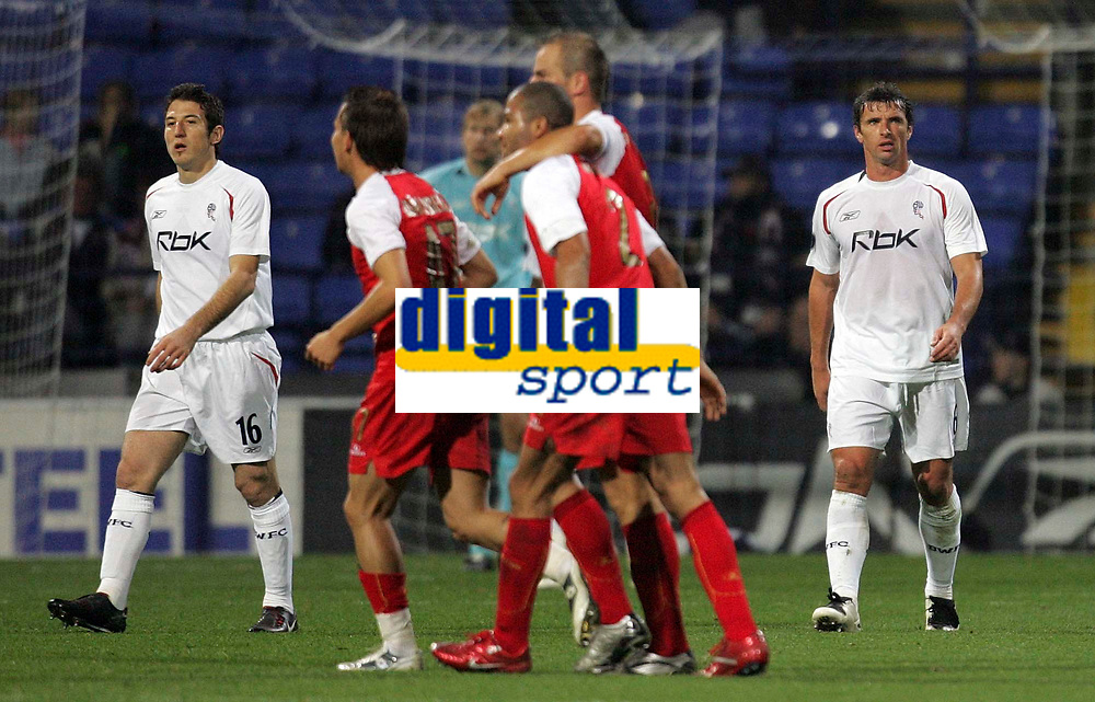 Photo: Paul Thomas.<br /> Bolton Wanderers v Braga. UEFA Cup. 25/10/2007.<br /> <br /> Dejected Andranik (16) and Gary Speed (6) of Bolton as Braga (Red) score to level.