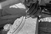 India, Pushkar, 1999. Using traditional tools, it will take this stone carver one month to finish a single sculpted window cornice.
