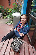Barranco, resident arrtists. Sculptor Silvia Westphalen portrayed in the garden of his house in the middle of two of his works.