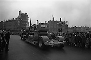 17/03/1965<br /> 03/17/1965<br /> 17 March 1965<br /> NAIDA St. Patrick's Day Parade, Dublin. Fiat Fl8 bulldozer on a McCairns Motors Ltd. carriercrossing O'Connell Bridge, shot for Gowran Steel Works.