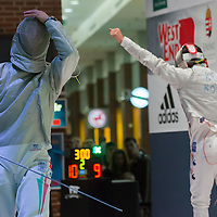 Aron Szilagyi (L) of Hungary reacts to a point scored by Kim Junghwan (R) of Korea fight during the final of the Gerevich-Kovacs-Karpati Men's Sabre Grand Prix in Budapest, Hungary on March 09, 2014. ATTILA VOLGYI