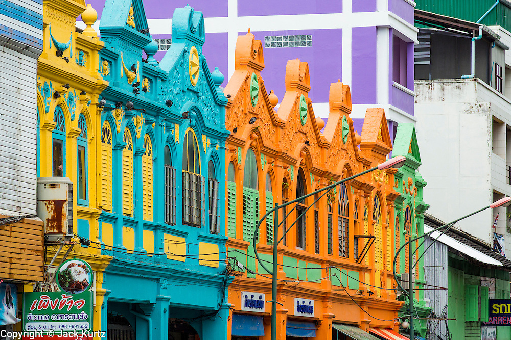 """23 OCTOBER 2012 - HAT YAI, THAILAND:  Old Chinese """"shophouses"""" in Hat Yai. Most of these old buildings in Hat Yai have been torn down to make way for, relatively featureless, concrete block construction. Hat Yai is the largest city in southern Thailand. It is an important commercial center and tourist destination. It is especially popular with Malaysian, Singaporean and Chinese tourists.     PHOTO BY JACK KURTZ"""
