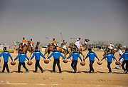 Boys carrying water for the contestants in the camel polo competition at the Desert Festival on 29th January 2018  in Jaisalmer, Rajasthan, India. It is an annual event that take place in February month in the beautiful city Jaisalmer. It is held in the Hindu month of Magh February, three days prior to the full moon.