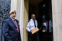 © Licensed to London News Pictures. <br /> 14/4/2017. London, Great Britain. <br /> Robin Horsfall former 22 SAS hands in a letter to the Prime Minister during the Justice for Northern Ireland Veterans March in central London.<br /> They are protesting the prosecution of former Service men and women who served in Northern Ireland during the Troubles.<br /> Photo credit: Anthony Upton/LNP