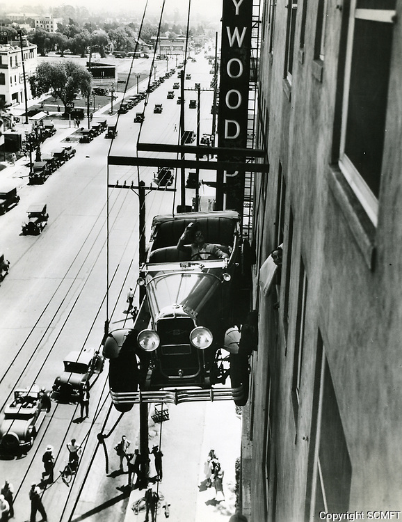 1928 A Buick is being deliver to Edward Everett Horton at the Hollywood Plaza Hotel on Vine St.
