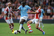 Manchester City's Yaya Toure (c) battles with Stokes Jonathan Walters and Stephen Ireland (l) during the Barclays Premier league match, Stoke city v Manchester city at the Britannia Stadium in Stoke on Trent on Sat 14th Sept 2013. pic by Jeff Thomas, Andrew Orchard sports photography,