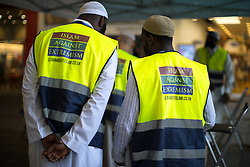 © Licensed to London News Pictures . 25/05/2017 . Manchester , UK . Men wearing ISLAM AGAINST EXTREMISM bibs on Market Street in Manchester City Centre , following a terrorist attack at an Ariana Grande concert at Manchester Arena that killed twenty two people . Photo credit : Joel Goodman/LNP