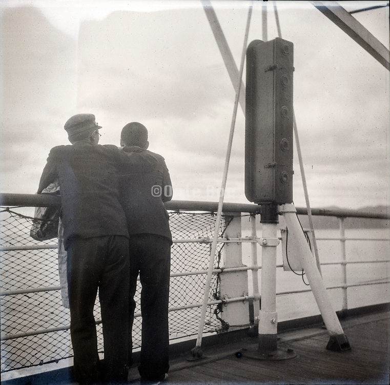 young boys on a ship looking towards the coast Japan ca 1940s