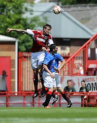 Bristol City's Aden Flint battles for the high ball with Glasgow Rangers' Nicky Clark - Photo mandatory by-line: Joe Meredith/JMP - Tel: Mobile: 07966 386802 13/07/2013 - SPORT - FOOTBALL - Bristol -  Bristol City v Glasgow Rangers - Pre Season Friendly - Bristol - Ashton Gate Stadium