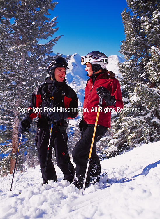 Alpine skiers Dylan Crossman and Brittany Lewis enjoying warm sun and each other's company at Alta, Little Cottonwood Canyon, Utah.