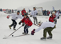 Tournament play at the New England Pond Hockey Classic on Meredith Bay.  (Karen Bobotas Photographer)