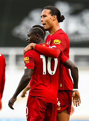 LIVERPOOL, ENGLAND - Sunday, July 26, 2020: Liverpool's Sadio Mané (L) celebrates with team-mate Virgil van Dijk after scoring the third goal during the final match of the FA Premier League season between Newcastle United FC and Liverpool FC at St. James' Park. The game was played behind closed doors due to the UK government's social distancing laws during the Coronavirus COVID-19 Pandemic. Liverpool won 3-1 and finished the season as Champions on 99 points. (Pic by Propaganda)