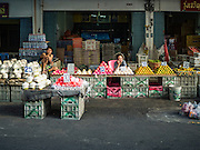 01 DECEMBER 2016 0 BANGKOK, THAILAND: Fruit vendor in the traditional market on Lan Luang Road in Bangkok. The market is on the site of one of the first western style cinemas in Bangkok. The movie theatre closed years ago and is still empty but the market fills the streets around the theatre.     PHOTO BY JACK KURTZ