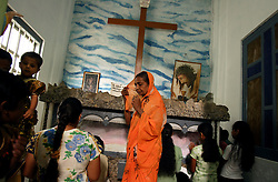 Residents of Dutch Bar attend Sunday services at neighboring St. Mary's Church, Batticaloa, Sri Lanka, Jan. 30, 2005. Residents of the small Christian village spent more than six weeks in a makeshift refugee camp at the local convent recovering from the devastating tsunami that hit the eastern and southern borders of Sri Lanka. They were then moved into another temporary living camp, while awaiting the building of new homes. More than 150 members in this community of less than 1000 people died in the tragic event.