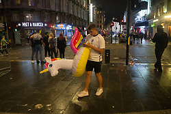 © Licensed to London News Pictures.  12/07/2021. London, UK. England football supporters make their way home from central London as England lose to Italy on penalties during the EURO 2020. Photo credit: Marcin Nowak/LNP