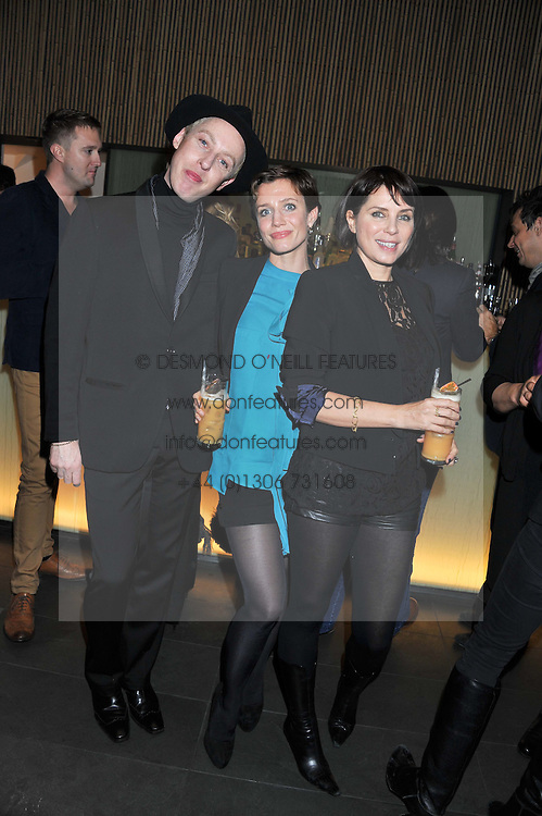 """Left to right, JAMES BROWN, LISA DAWN and SADIE FROST at a party to celebrate the launch of Meg Matthews' blog - """"Meg says"""" at the bar at Ni Ju San, 23 St.James's Street, London on 1st December 2011."""