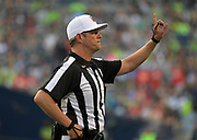 Aug 25, 2017; Seattle, WA, USA; NFL referee Craig Wrolstad (4) gestures during a NFL football game between the Seattle Seahawks and the Kansas City Chiefs at CenturyLink Field. The Seahawks defeated the Chiefs 26-13.
