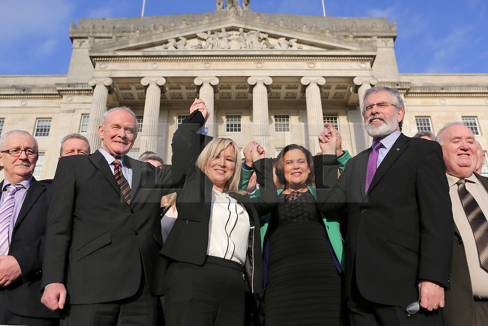 © Licensed to London News Pictures. STORMONT BELFAST - 23 JAN 2017: Sinn Fein's Michelle O'Neill (centre) stands with Martin McGuinness, Mary Lou McDonald and Gerry Adams, on the steps of Stormont after being named as the politician who will take over from former deputy first minister Martin McGuinness who has retired due to illness.. Photo credit: London News Pictures.