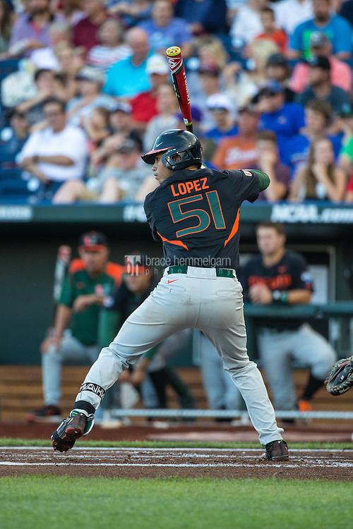 Brandon Lopez (51) of the Miami Hurricanes bats during a game between the Miami Hurricanes and Florida Gators at TD Ameritrade Park on June 13, 2015 in Omaha, Nebraska. (Brace Hemmelgarn)