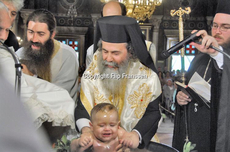 Griekenland, Athene, 5-7-2018In een kerk vindt de doop plaats van een kind uit een rijke familie.In a church a child of a wealthy family is being baptised.Foto: Flip Franssen