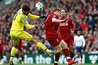 Football - 2018 / 2019 Premier League - Liverpool vs. Tottenham Hotspur<br /> <br /> Alisson Becker of Liverpool and team mate James Milner collide in mid air, at Anfield.<br /> <br /> COLORSPORT/ALAN MARTIN