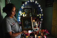"""MEXICO, Veracruz, Tantoyuca, Oct 27- Nov 4, 2009. A family altar in Santa Maria de Ixcatepec. """"Xantolo,"""" the Nahuatl word for """"Santos,"""" or holy, marks a week-long period during which the whole Huasteca region of northern Veracruz state prepares for """"Dia de los Muertos,"""" the Day of the Dead. For children on the nights of October 31st and adults on November 1st, there is costumed dancing in the streets, and a carnival atmosphere, while Mexican families also honor the yearly return of the souls of their relatives at home and in the graveyards, with flower-bedecked altars and the foods their loved ones preferred in life. Photographs for HOY by Jay Dunn."""