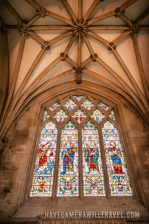 Stained glass windows of Wells Cathedral in Wells, Somerset, United Kingdom. Some of the building dates back to the 10th Century.