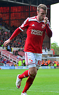 Andy Williams celebrates scoring the equaliser during the Sky Bet League 1 match between Swindon Town and Leyton Orient at the County Ground, Swindon, England on 3 May 2015. Photo by Alan Franklin.