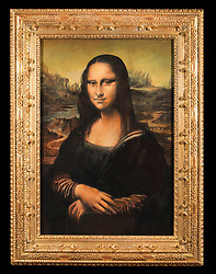 """August 14, 2017 - inconnu - A painter hailed as """"the world's finest living art forger"""" has joined forces with a micro sculptor to create a £1 million version of the Mona Lisa.John Myatt has painted a version of Leonardo da Vinci's masterpiece.He has teamed up with UK-based Willard Wigan , who specialises in tiny sculpture that fit in the eye of a needle.Wigan ,59 , has created an almost microscopic Mona Lisa replica that features in the left eye of Myatt's version.The rendering measures just under 1mm squared and is in it's own real 24 carat gold frameWigan painted it with the hair of a fly.The finished work, titled Mona Lisa: Secret In The Eye, is available to view online, and purchase through, luxury website VeryFirstTo.com for £1 million GBP / $1,252,200 USD / €1.118 million Euros. It is also exhibited at, and available for purchase at, London's Trinity House Paintings Gallery, London, Mayfair now and in its New York Gallery soon after.The fake Mona Lisa sits in a hand-carved carved frame.A spokesman for VeryFirstTo said:"""" To the globally recognised enigmatic smile and follow-you eyes, this totally authentic-looking portrait reproduces the painting's outstanding beauty.""""One can just about detect, with the naked eye, that Mona Lisa's right pupil has something within it. """"However, one can only establish that this spec in the eye is, in fact, a miniature portrait of the Mona Lisa with the assistance of a strong magnifier. """"Wigan, who has to go into a trance-like meditative state to slow down his nervous system so he can work between heartbeats, has somehow managed to capture the protagonist's distinctive features on the most miniscule of canvases. """"The spokesman said before creating the work, Myatt and Wigan had never met.He added:"""" Reports of a secret code being discovered in the eyes of the world's most famous painting, simultaneously ignited"""