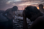 Migrants have to wash outside in the cold,  warming some water in an old barrel.  Belgrade, Serbia. January 14th 2016 Federico Scoppa