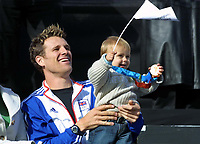 Foto: Colorsport/Digitalsport<br /> NORWAY ONLY<br /> <br /> James Cracknell (GBR) Mens Coxless 4 Gold Medalist with his baby, cheer with the Crowd. Olympic Parade of Medal winners in London. Trafalgar Square. 18/10/2004.
