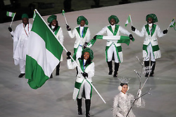 February 9, 2018 - PyeongChang, South Korea - The Nigeria team marches in, led by flag bearer NGOZI ONWUMERE during the Opening Ceremony for the 2018 Pyeongchang Winter Olympic Games, held at PyeongChang Olympic Stadium. (Credit Image: © Scott Mc Kiernan via ZUMA Wire)