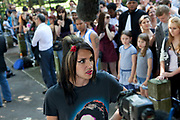 "Brandon Hayward (16) a loyal and deeply upset and distressed Amy Winehouse fan talks to the media at the memorial opposite the home of Amy Winehouse, Camden Square, North London. In signature make up and wearing a t-shirt of her image, he said ""It's destroyed me. It's killed me. We hadn't seen too much of her in the press recently so thought things were alright, and now this, she's died. I don't know what to do, how I can make it better."" Brandon had first seen Winehouse at his first ever gig just aged 12 years old. It was announced that the tragic singer had died on 23rd July 2011. The music world has been paying tribute to singer Amy Winehouse, 27, who was found dead at her London home following years of drug and alcohol abuse largely attributed to her troubled character and fame."
