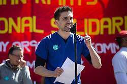 © Licensed to London News Pictures. 01/05/2016. London, UK.  Yannis Gourtsoyannis, a member of the BMA's junior doctors committee national executive speaks to demonstrators in the annual May Day march in London's Trafalgar Square to mark International Workers' Day.  Photo credit: Joel Ford/LNP