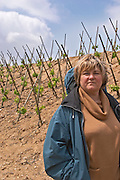 The vineyard of Pierre Gaillard in Malleval where he makes wines of the appellations Cote Rotie, Condrieu, and Saint Joseph.  On the plateau, high lying land, above the actual Rhone valley along the river. Pascale Gaillar, wife of Pierre, in the vineyard. This particular vineyard is in Saint Joseph.  Domaine Pierre Gaillard, Malleval, Ardeche, ardèche, France, Europe