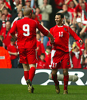 Photo: Scott Heavey<br />Wales V Azerbaijan. 29/03/03.<br />Ryan Giggs celebrates with John Hartson during this afternoons Euro 2004 Group 9 qualifying match at the Millenium stadium in Cardiff.