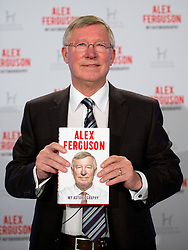 © London News Pictures. 22/10/2013 . London, UK.  Former Manchester United manager SIR ALEX FERGUSON poses with a copy of his new autobiography titled 'SIR ALEX FERGUSON - MY AUTOBIOGRAPHY' at a press conference in central London held ahead of the publication of his autobiography on October 24. Photo credit : Ben Cawthra/LNP