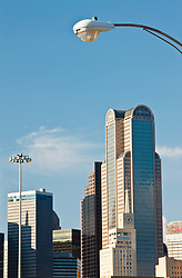 Street lamp over downtown buildings, Dallas, Texas, USA.