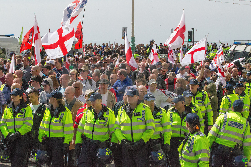© Licensed to London News Pictures . 21/04/2013 . Brighton , UK . The March for England march . Nationalist group March for England hold a march along Brighton seafront today (Sunday 21st April) . The group was supported by supporters of the English Defence League and opposed by anti fascist and left wing groups . The annual march takes place close to St George's Day and frequently results in scuffles and violence between opposing groups and police . Photo credit : Joel Goodman/LNP