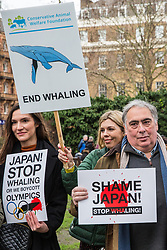 London, UK. 26th January, 2019. East of England MEP John Flack (r) and ocean conservationist Carrie Symonds (c), girlfriend of former Foreign Secretary Boris Johnson, join animal rights campaigners preparing to take part in the Japan: No Whaling march from Cavendish Square to the Japanese embassy following Japan's announcement that it withdraw from the International Whaling Commission (IWC) and resume commercial whaling with effect from July 2019. The march was organised by the London Committee for the Abolition of Whaling.