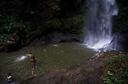 Children diving on a waterfall lake near Cerro Punta in Panama