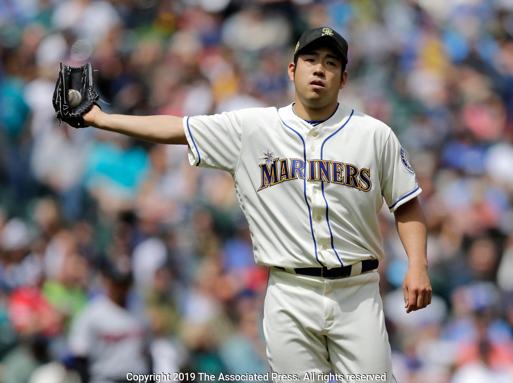 Seattle Mariners starting pitcher Yusei Kikuchi catches the ball from the catcher while working against the Minnesota Twins during a baseball game, Sunday, May 19, 2019, in Seattle. The Mariners went on to win 7-4. (AP Photo/John Froschauer)