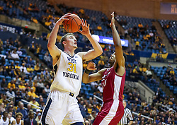 Nov 28, 2018; Morgantown, WV, USA; West Virginia Mountaineers forward Logan Routt (31) drives baseline during the second half against the Rider Broncs at WVU Coliseum. Mandatory Credit: Ben Queen-USA TODAY Sports