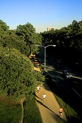 Stock photo of joggers along Memorial Drive in Memorial Park.